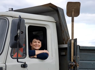 a woman who has chosen a trucking career