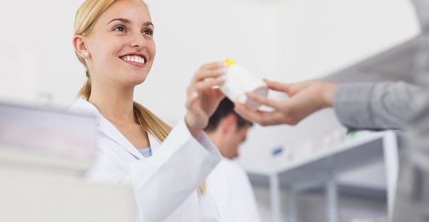 Happy female pharmacy technician smiling