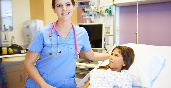 A certified nursing assistant comforts a patient
