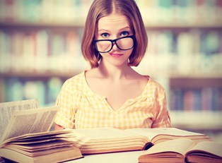 Young girl researches the pros and cons of substitute teaching