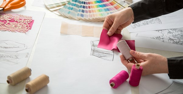 Fashion designer tests colors and fabric for potential designs