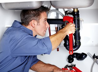 Plumber fixes plumbing issues