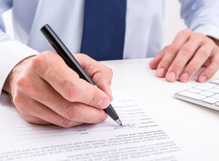 Insurance agent fills out paperwork