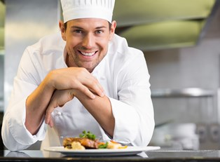 A chef poses with his food