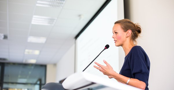 A life coach gives a motivational speech at a conference