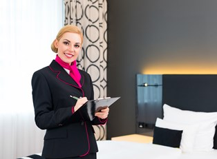A hospitality manager checks things off of her list