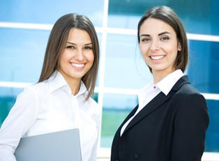 Two social workers smile