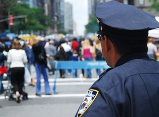 A police officer surveys the crowd