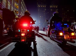 Police officers ride on motorcycles