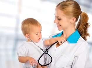 A physician assistant plays with a baby