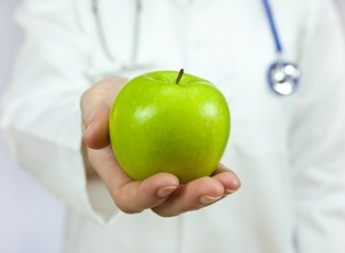 A dietitian holds an apple
