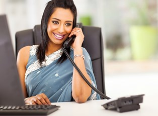 A receptionist takes a phone call