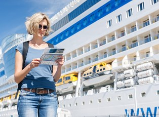 A woman takes a tour of a cruise ship