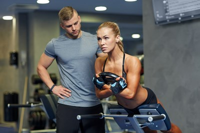 A personal trainer works with his client