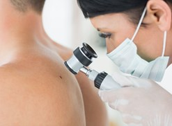 A dermatologist checks out a funky mole
