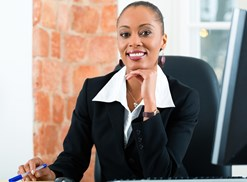 A paralegal works at her desk