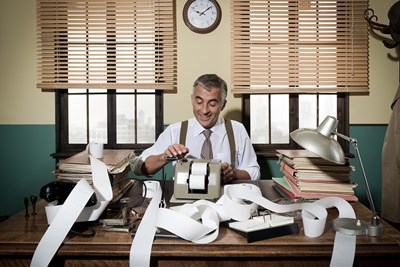 An accountant goes over some paperwork