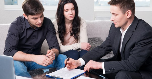 An insurance agent consults with clients