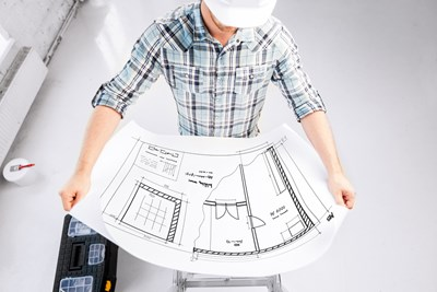An architect looks at a blueprint