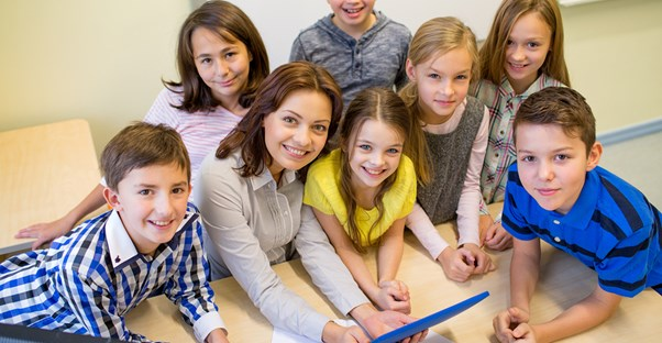 A speech pathologist works with a group of young children