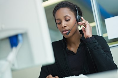 Woman at computer talking on headset