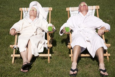 a man and a woman relax in the sun and enjoy their retirement