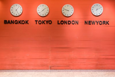 Four time zone clocks on a wall