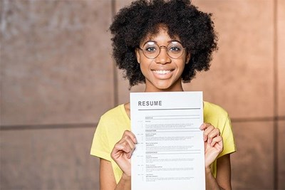 woman holding up resume