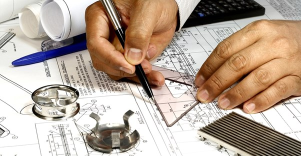 Aspiring mechanical engineer working on a design in a mechanical engineering internship
