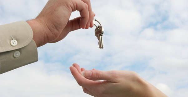 Real estate agent hands over the keys to a new home