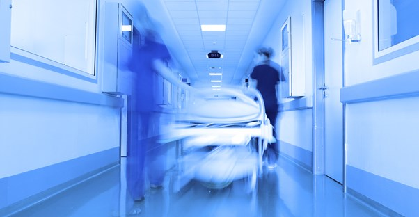 A patient is rushed down a hospital hallway