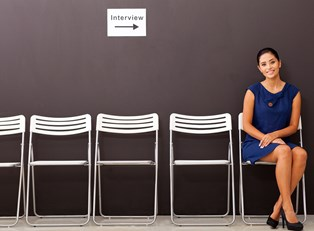 Girl in a dress sits and waits for her job interview
