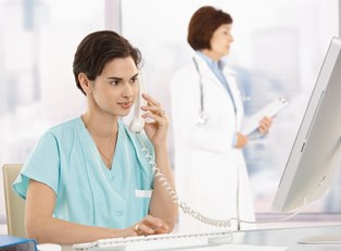 A medical billing and coding specialist answers a phone