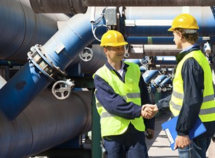 Chemical engineers shake hands