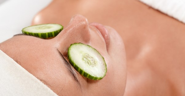 A woman relaxes with cucumbers on her eyelids
