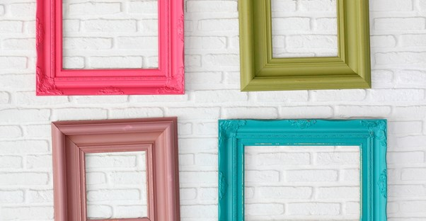 Empy picture frames hang on a wall