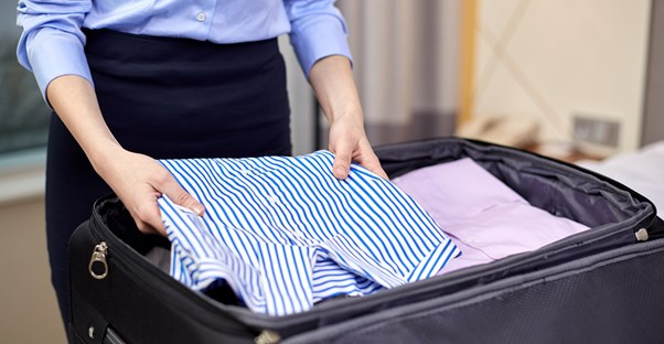 Woman packs a capsule wardrobe for her business trip